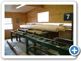 Milled logs ready for pre-cutting MFG-071